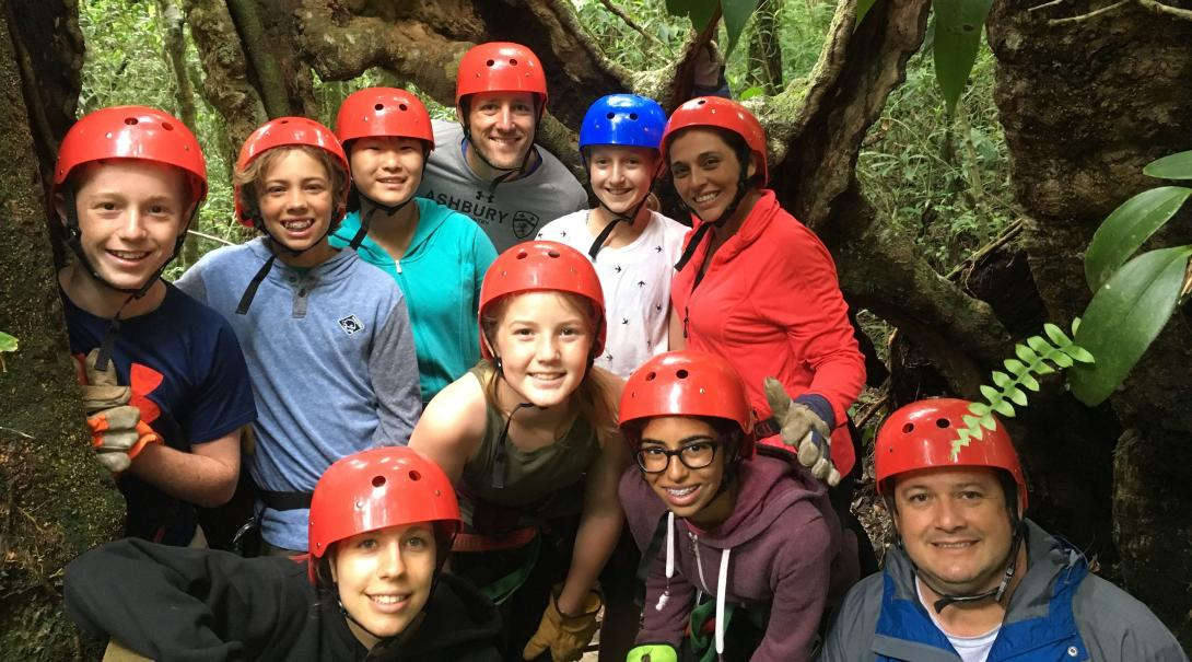 Conservation volunteers prepare for a zipline experience through the Costa Rican forest.